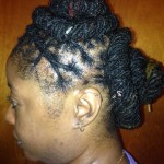 Barrel Roll Updo with locs